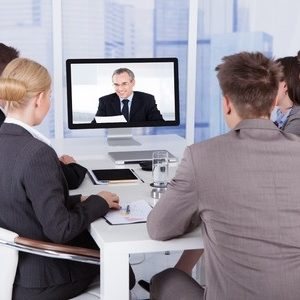 30069155 - group of business people in video conference at meeting table